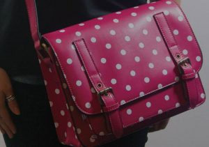 A background image showing a handbag from Mimi's ecommerce store