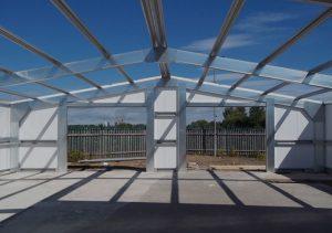 A background image of a steel framed building